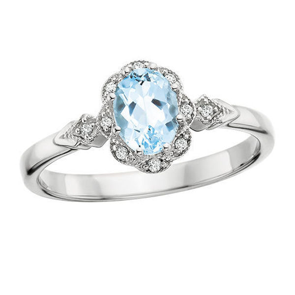 Picture of Floral halo of Diamonds Framing a Pool of Aquamarine Ring
